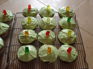 Cupcakes, lime green and silver with gummy bears.