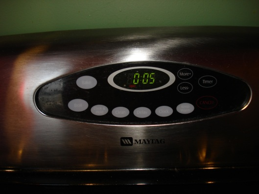 Put baking sheets in oven and set timer for 5 minutes.