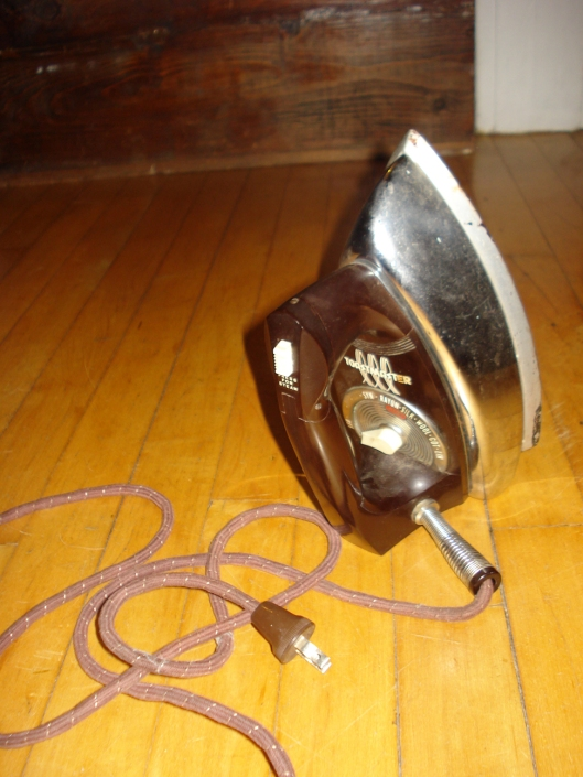 The Old Workhorse Iron - a Toastmaster. It's so old, it doesn't even have a cutesy model name. Note the cloth-covered cord.