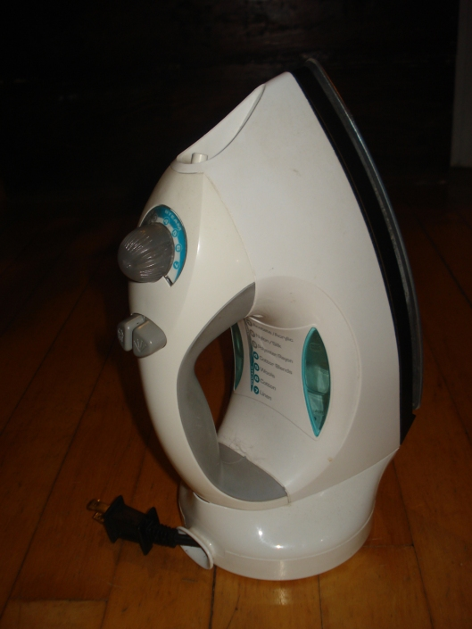 Black & Decker Steamxpress Iron with broken switch. I love the roll-up cord feature and light weight of this iron.