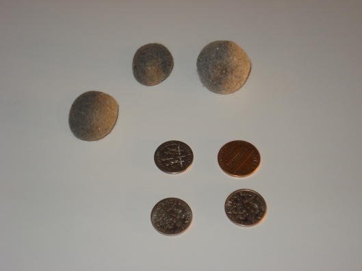 Three felt balls and 31-cents found in fins of Maytag dryer.