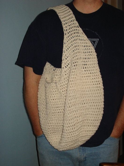 My ecru crocheted produce bag, modeled by my Lovin' Spouseful Erik, May 27, 2010.