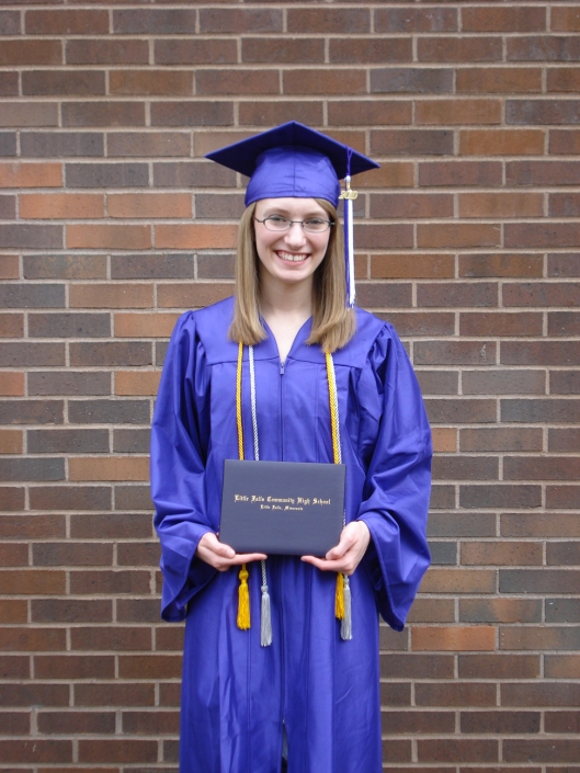 Daughter with her high school diploma, May 30, 2010.