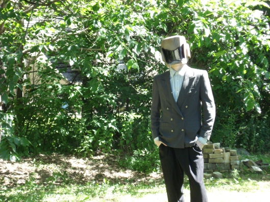 Eldest Son in helmet and suit jacket, July 2010