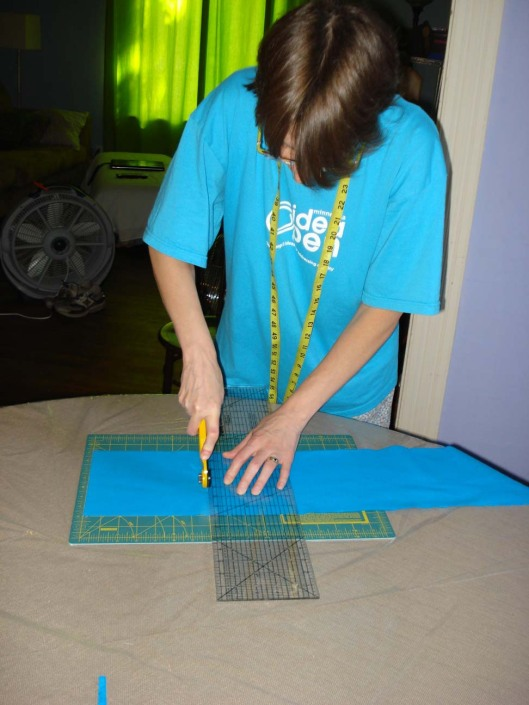 Me, cutting quilt squares, August 28, 2010.