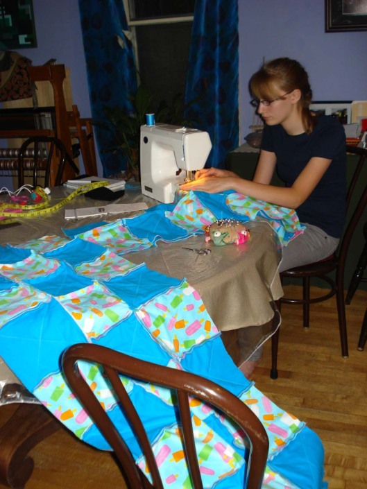 Daughter sewing strips together, Aug. 28, 2010.