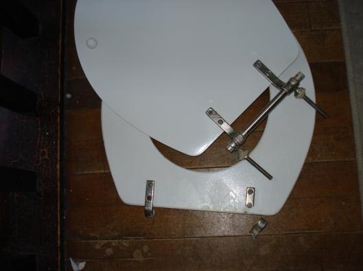 Broken toilet seat, December 2010