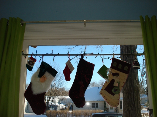 Christmas stockings in the window, December 2010.