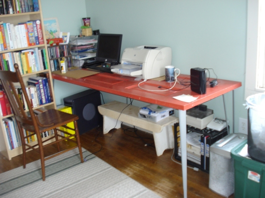 BEFORE: Here's my desk in its old location. It's an old door with table legs added. It's full door length. Because of this, there was only one place I could put it in this particular room. January 2, 2011.