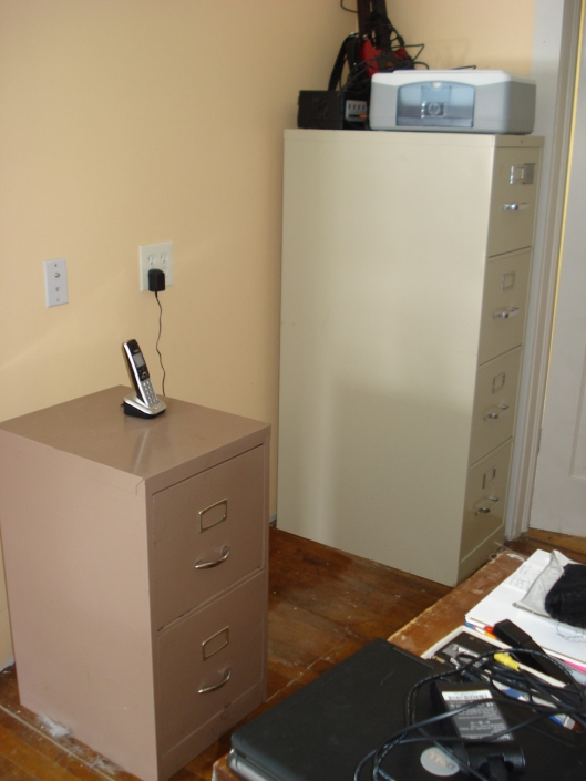 IN BETWEEN: Here is the new location for the desk, without the desk having been moved yet. In between these filing cabinets sat a small dresser upon which there was a television. We gave the TV to my sister over Christmas and moved the dresser to Eldest Son's room. January 2, 2011.