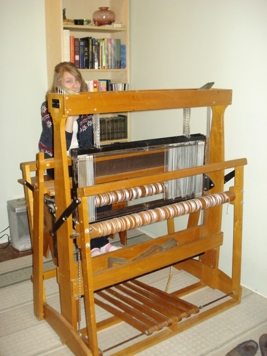 AFTER, PART II: The loom in its new location, where the desk used to be. Daughter is sitting behind the loom, brushing her teeth. She happened to move into the shot as I was documenting it for the blog. January 2, 2011.