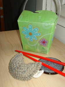 Amigurumi fortune cookie with chopsticks and Asian food container (that really holds office clips). January 2011.