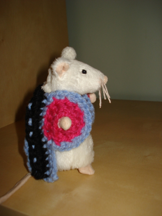 Side view of crocheted coat by Mary Warner for IKEA mouse, August 15, 2011.