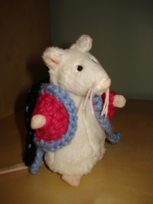 Crocheted coat by Mary Warner for IKEA mouse, August 15, 2011.