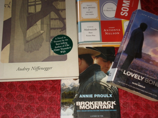 Four books from the library, August 25, 2011.