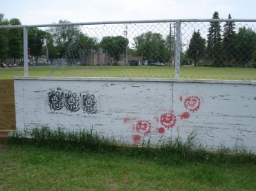 Graffiti in North End Playground skating rink, Little Falls, MN, May 27, 2012.
